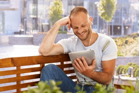 Man reading iPad